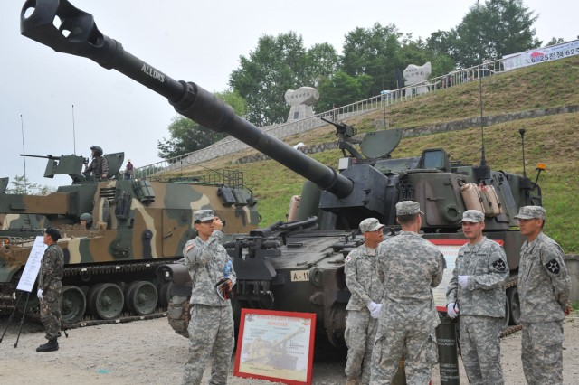 Soldiers from the 2nd Infantry Division stand next to a static display of a M109A6 Paladin 155mm Howitzer following the live-fire exercise, June 22, 2012, in Pocheon, South Korea.