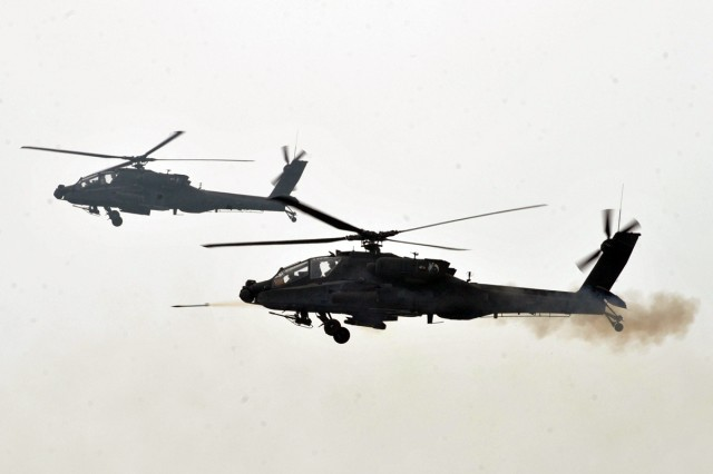 U.S. Army Apache attack helicopters from the 2nd Combat Aviation Brigade, 2nd Infantry Division, participate in a live-fire exercise June 22, 2012, in Pocheon, South Korea.