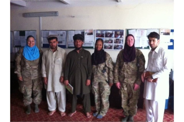 PAKTIKA PROVINCE, Afghanistan --  The 4th Infantry Brigade Combat Team, 1st Infantry Division's female engagement team poses with members of the municipal staff and Afghanistan Relief and Rehabilitation Organization after a meeting discussing the need for women's initiatives in Paktika Province, Afghanistan, June 20. (U.S. Army Courtesy Photo)