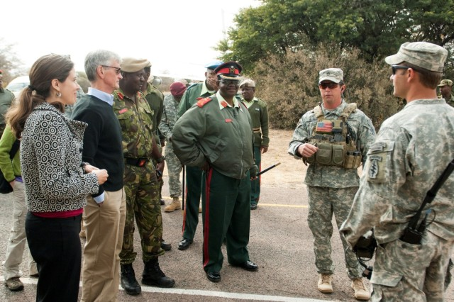 U.S. Ambassador to Botswana Michelle D. Gavin, left, and Secretary of the Army John McHugh listen as U.S. Army Special Forces Soldiers and Botswana Defense Force officers discuss Exercise Eastern Piper 2012 prior to a capabilities demonstration by Botswana Defence Force soldiers June 20, 2012, near Gaborone, Botswana.