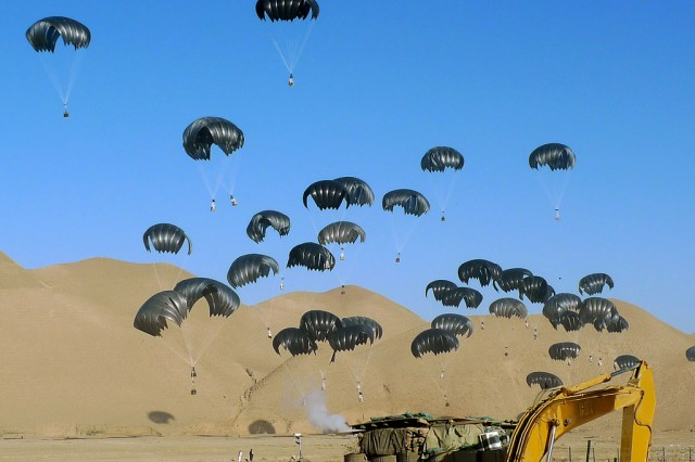 Cargo parachutes drop fuel to a combat outpost in Afghanistan, Sept. 16, 2011. Army researchers are testing a quick release system to be fielded later this year.