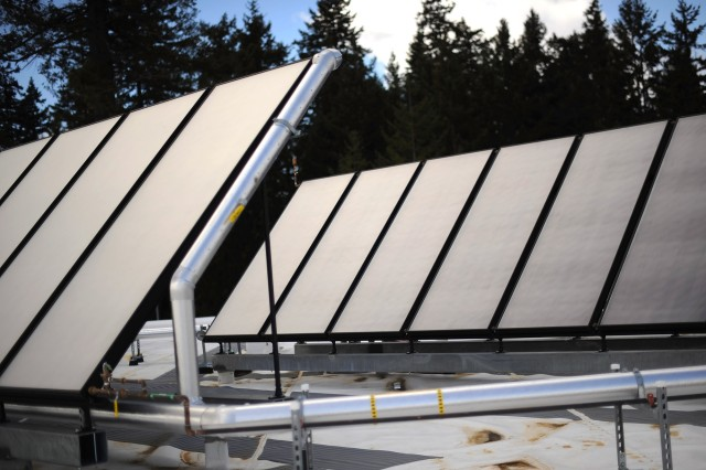 Solar panels installed at the Nisqually Medical Dental building at Joint Base Lewis-McCord, Wash., convert sunlight into energy. The solar power works in tandem with the building's water heater to keep the center warm.