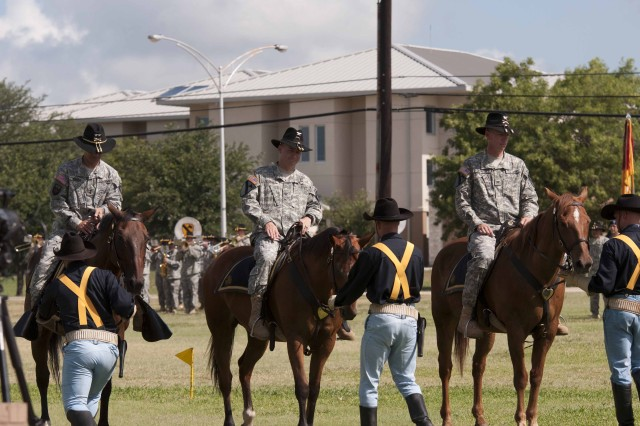 FORT HOOD, Texas --Maj. Gen. Anthony Ierardi, commanding general of the 1st Cavalry Division, Col. Douglas Crissman, former commander 3rd Brigade Combat Team, and Col. David Lesperance, commander of the 3rd BCT, prepare to conduct a mounted troop inspection before transferring the brigade's colors at a change of command ceremony on Cooper Field June 21, 2012.