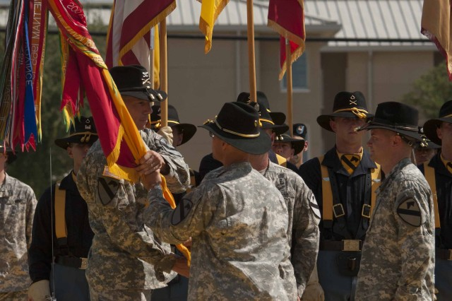 FORT HOOD, Texas --Col. David Lesperance, commander of the 3rd Brigade Combat Team, 1st Cavalry Division, accepts the unit's colors and command of the brigade from the Division's Commander Maj. Gen. Anthony Ierardi at a change of command ceremony on Cooper Field June 21, 2012.