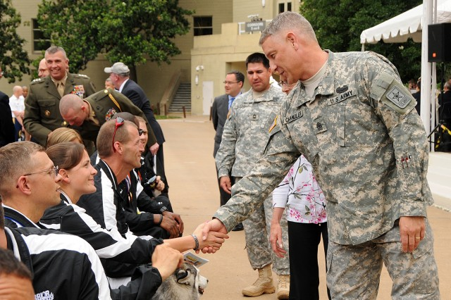 Sgt. Maj. of the Army Raymond F. Chandler III shakes hands with Sgt. Margaux Vair, who is now medically retired from the Army, at the Department of Defense Warrior Games Recognition Ceremony, June 25, 2012, in the Pentagon Courtyard.  Vair earned multiple medals in the recent 2012 Warrior Games in Colorado Springs, Colo.  She was one of ten Soldiers asked to represent all Army participants of those games at the Pentagon ceremony.