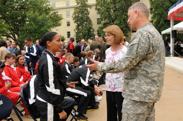 Sgt. Maj. of the Army Raymond F. Chandler III and his wife, Jeanne, meet with 1st Lt. Lacey Hamilton, during the Department of Defense Warrior Games Recognition Ceremony, June 25, 2012, in the Pentagon Courtyard.  Lacey participated in the recent 2012 Warrior Games in Colorado Springs, Colo.  She was one of ten Soldiers asked to represent all Army participants of those games at the Pentagon ceremony.