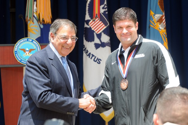 Secretary of Defense Leon E. Panetta presented his coin to Staff Sgt. John Masters, during the Department of Defense Warrior Games Recognition Ceremony, June 25, 2012, in the Pentagon Courtyard.  Masters participated in the recent 2012 Warrior Games in Colorado Springs, Colo.  He was one of ten Soldiers asked to represent all Army participants of those games at the Pentagon ceremony.