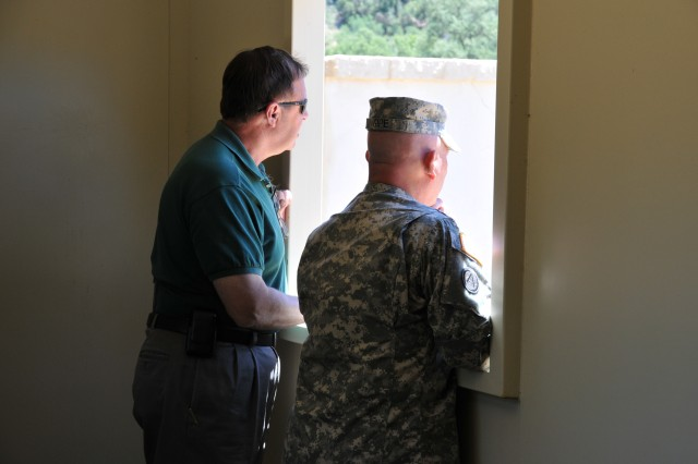 Robert Smiley and Command Sgt. Maj. John Gipe, both from the Office of the Secretary of Defense for Reserve Affairs, observe training at one of the many mock villages, or MOUT sites, at Fort Hunter Liggett.