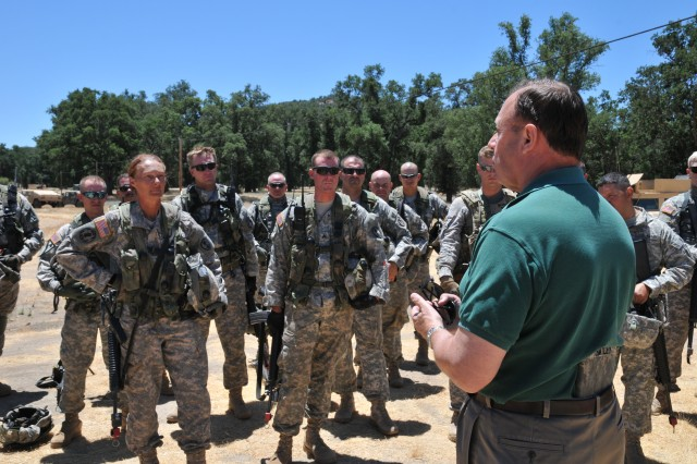 Robert Smiley, from the Office of the Secretary of Defense for Reserve Affairs, speaks with Soldiers at Fort Hunter Liggett during cordon and search exercises at one of Fort Hunter Liggett's many mock villages, or MOUT sites.
