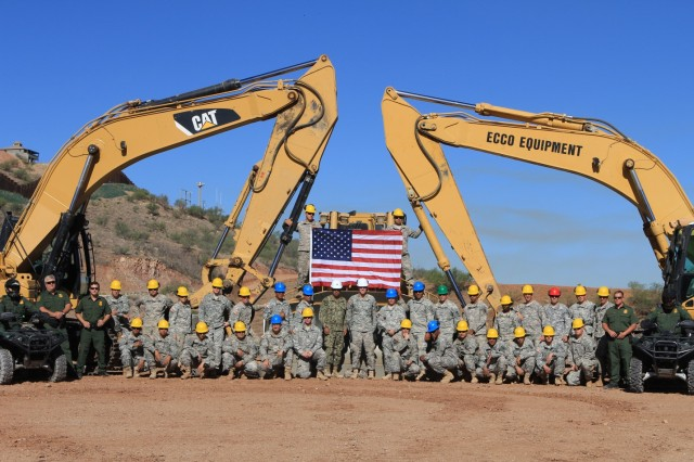 Soldiers with 1st Platoon, 561st Engineer Company, 84th Engineer Battalion, 130th Engineer Brigade, 8th Theater Sustainment Command, gather for a photo after improving a road in support of the United States Border Patrol along the U.S.-Mexico border in southern Arizona.