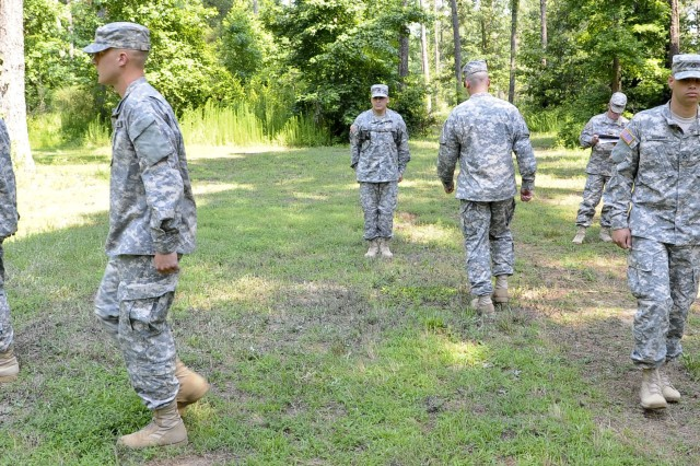 """Four Soldiers perform a """"Counter Column"""" drill movement at the direction of Staff Sgt. Cesar Ruiz, from Fort Benning, Ga., June 25, 2012, during the annual Drill Sergeant of the Year competition held at Fort Eustis, Va. During the week-long competition hosted by Initial Military Training, U.S. Army Training and Doctrine Command, six drill instructors compete in various events to determine who wins the title."""
