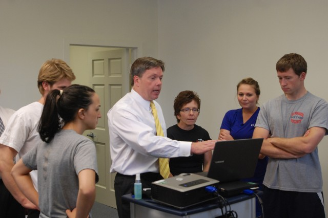 Carlisle Barracks Army Wellness Center staff members discuss multiple uses of a state-of-the-art ultrasound that measures body composition as they set to open in July.