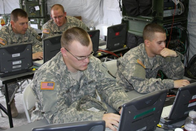 Soldiers with the 504th Signal Company, 16th Special Troops Battalion, 16th Sustainment Brigade, configure the call managers for voice over internet protocol phones during network training and new equipment fielding on Warner Barracks, Bamberg, Germany, June 21. (Photo by 16th STB Public Affairs)