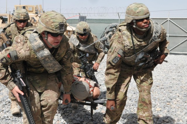 From left, Spc. Larry Harper of the 209th Aviation Support Battalion, Spc. Martin A. Cardenas, Sgt. Raul Zepeda and 2nd Lt. Andre Mathews Sr. of the 57th Expeditionary Signal Battalion (right), transport a simulated casualty during medical training at the Medical Simulation Training Center at Kandahar Airfield, June 14. Kandahar Airfield features one of only two Medical Simulation Training Centers in Afghanistan.