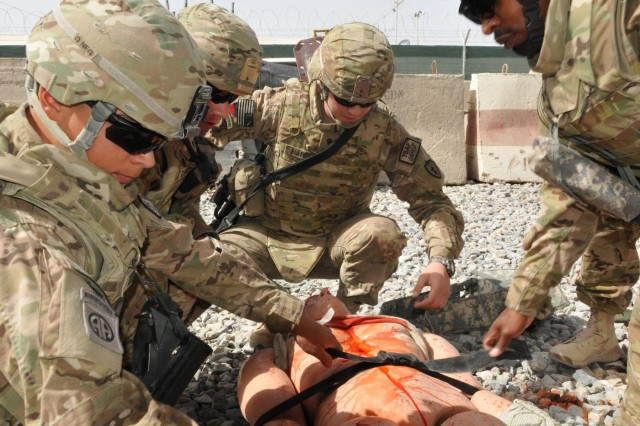 From left, Sgt. Raul Zepeda and Spc. Martin A. Cardenas of the 57th Expeditionary Signal Battalion along with Spc. Larry Harper of the 209th Aviation Support Battalion and Senior Airmen Jerome Williams, Jr. (right) of the Defense Contract Management Agency evaluate, treat and secure a simulated casualty during medical training at the Medical Simulation Training Center at Kandahar Airfield, June 14. Kandahar Airfield features one of only two Medical Simulation Training Centers in Afghanistan.