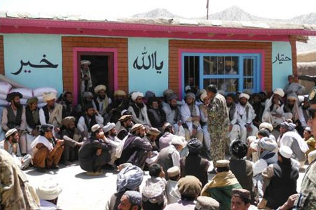 Afghan National Army Lt. Col. Mirweis, in partnership with Soldiers from the 1st Squadron, 4th Cavalry Regiment, talks with the elders in the rarely visited Omnah District of Paktika province, Afghanistan, June 14, 2012. The district had only been visited by American forces once before.