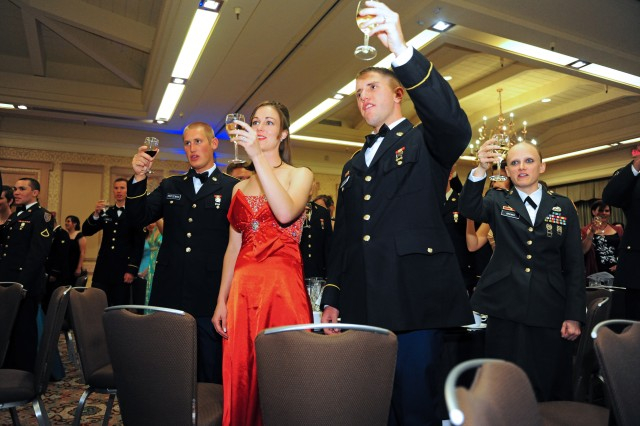 "PRESIDIO OF MONTEREY, Calif. -- Soldiers and guests raise their glasses inside the grand ballroom of the Hyatt Regency Monterey during the traditional ""giving of toasts"" at the 229th Military Intelligence Battalion Army Birthday Ball June 9."