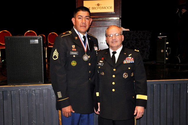 Staff Sgt. Oscar Hernandez, left, is the platoon sergeant for Headquarters and Headquarters Company with the 53rd Signal Battalion in Colorado Springs, Colo. Here he is with Lt. Gen. Richard P. Formica, The U.S. Army Space and Missild Defense Command/Army Forces Strategic Command commanding general.