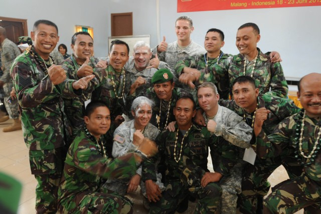 Instructors from 18th Medical Command (Deployment Support), 1984th U.S. Army Hospital, Detachment 2, 9th Mission Support Command,  officers and non-commissioned officers of the Indonesian Army pose for a photo after the closing ceremony for the Medical First Responder course one of the events during Exercise Tendon Valiant 2012 a six day multi-national Medical Readiness Training Exercise, led by 18th Medical Command (Deployment Support), and US Army Pacific, Surgeon's office  and hosted by the Indonesian National Armed Forces - Tentara National Indonesia 18-23 June.