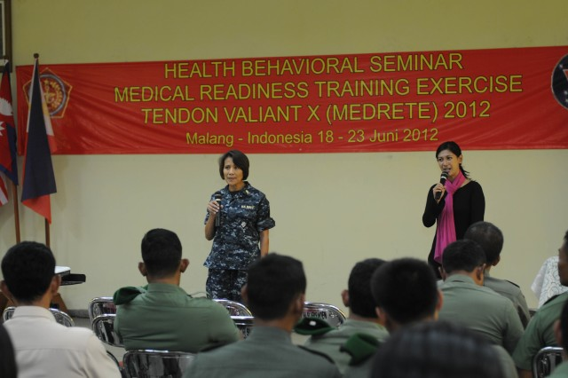 Rear Admiral Raquel Bono, Command Surgeon, U.S. Pacific Command, speaks, with the help of an interpreter, during a health behavioral seminar for Indonesian National Armed Forces personnel one of the events during Exercise Tendon Valiant 2012 a six day multi-national Medical Readiness Training Exercise, led by 18th Medical Command (Deployment Support), and US Army Pacific, Surgeon's office and hosted by the Indonesian National Armed Forces - Tentara National Indonesia 18-23 June.