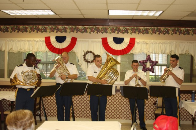 "Members of the Army Materiel Command Band play patriotic songs during a barbecue at the Floyd E. ""Tut"" Fann State Veterans Home June 23. The event was hosted by members of the Redstone-Huntsville Chapter of the Association of the United States Army in conjunction with the Military Officers Association of America, the Sergeants Major Association and the United States Army Warrant Officers Association to show their appreciation for all that veterans have done throughout the years for the country."