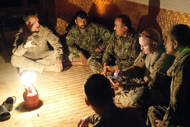 Capt. Philip Schneider, a company commander with the 82nd Airborne Division's 1st Brigade Combat Team, explains recent events in the villages around Joint Security Station Hasan to Afghan army commanders and his battalion commander, Lt. Col. Robert Salome, June 11, 2012, Ghazni Province, Afghanistan.  Schneider commands Company D, 1st Battalion, 504th Parachute Infantry Regiment.