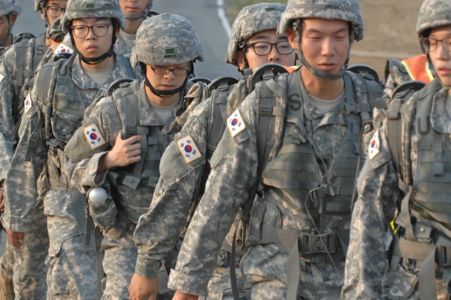 Korean Augmentation to the United States Army, or KATUSA, soldiers complete their journey around Perimeter Road during a march commemorating the beginning of the Korean War, at Camp Humphreys, South Korea, June 25, 2012.