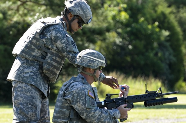 Drill Sergeant Marquez demonstrates M203 grenade launcher at DSOY competition