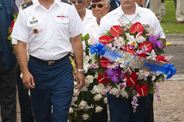 Col. Glenn Grothe, chief of staff for the 8th Theater Sustainment Command, and Spc. Andrew Armstrong, protocol Soldier for the 8th TSC, carry a commemorative wreath that the 8th TSC laid on the Korean War memorial during the 62nd Korean War Commemoration at the National Memorial Cemetery of the Pacific, June 25.