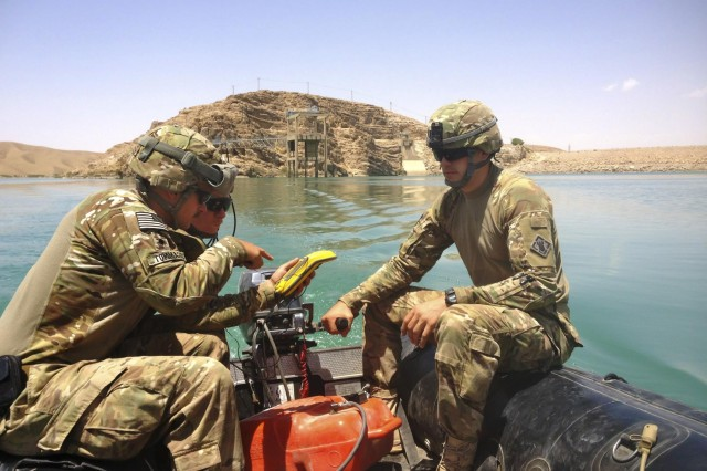 Spc. Matthew Tommaso (left), Staff Sgt. Bryan Crowley (center), and 1st Lt. Michael Jappe (right) conduct a hydrographic survey at Kajaki Dam in southern Afghanistan. The Soldiers are members of 569th Engineer Dive Detachment, which deployed to Afghanistan to support the U.S. Army Corps of Engineers Afghanistan Engineer District-South, by conducting hydrographical surveys and inspections of underwater structures at Kajaki and Dahla Dams.
