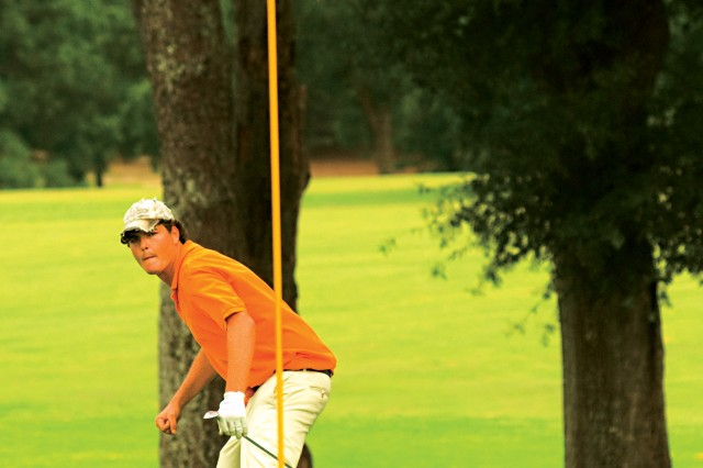 Daniel Kirkland fist pumps as he watches his chip on Marshall No. 9 fall into the cup Sunday, giving him the win at the 33rd annual Purple and Gold Golf Tournament held at Fort Benning Golf Course.