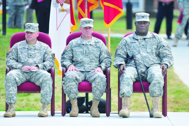 Col. John Strycula, outgoing Fort Belvoir Garrison commander, (right) Lt. Gen. Michael Ferriter, U.S. Army Installation Management Command, commander, (center) and Col. Gregory D. Gadson, incoming garrison commander, obverve Fort Belvoir's Garrison change of command ceremony, June 25.