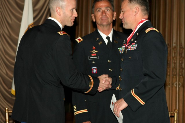 New Philadelphia District Commander Lt. Col. Chris Becking (left) thanks outgoing commander Lt. Col. Philip Secrist (right) during the Change of Command ceremony June 26th. North Atlantic Division Commander Christopher J. Larsen (center) presided over the ceremony.
