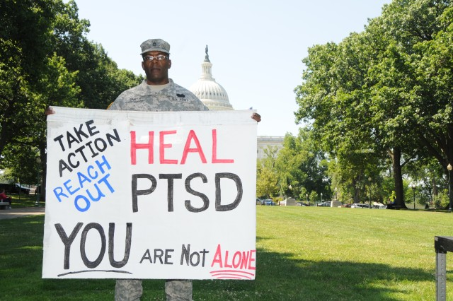 Sgt. 1st Class Kendrick J. Smith poses in front of the Capitol in Washington, D.C., June 27, 2012, for National Post-Traumatic Stress Disorder Awareness Day.