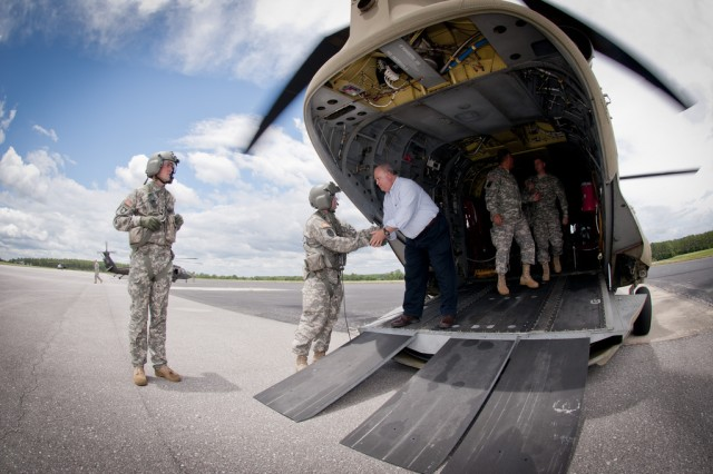 Under Secretary of the Army Joseph W. Westphal thanks a member of the flight crew of the CH-47F Chinook helicopter after an aerial tour of Fort Rucker, Ala.