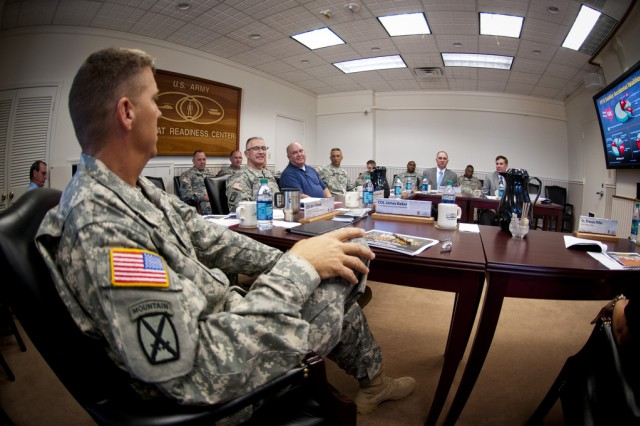 Under Secretary of the Army Joseph W. Westphal flanked by Brig. Gen. Timothy J. Edens and Command Sgt. Maj. Richard D. Stidley receives a briefing on Army safety inititiatives at the U.S. Army Combat Readiness/Safety Center, Fort Rucker, Ala.
