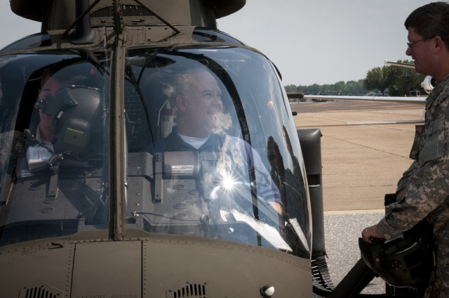 Under Secretary of the Army Joseph W. Westphal prepares to receive a flight demonstration in an OH-58D Kiowa Warrior helicopter at Cairnes Army Airfied, Fort Rucker, Ala.