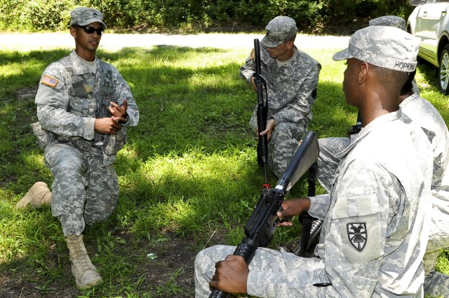 """Staff Sgt. Danneit Disla, right, 98th Reserve Division drill sergeant, explains the process of """"breaking contact"""" to his squad prior to completing the exercise, June 27, 2012, during the annual Drill Sergeant of the Year competition, hosted by Initial Military Training, U.S. Army Training and Doctrine Command, at Fort Eustis, Va. At this station Disla was required to explain and then have his team properly execute the process."""