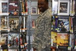 Soldier looks at DVD selection at newly remodeled library
