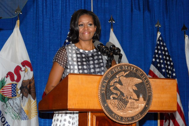 """Michelle Obama addresses the audience at the historic bill-signing ceremony at the Calumet armory in Chicago, June 26, 2012. At the event, Illinois Governor Pat Quinn signed into law the """"Military Family Licensing Act,"""" making Illinois the 23rd state to adopt pro-military spouse license portability legislation when the law takes effect Jan. 1, 2013. The bill provides for temporary expedited professional and educational licenses for active duty members of the military and their spouses after the families relocate to Illinois for military service."""