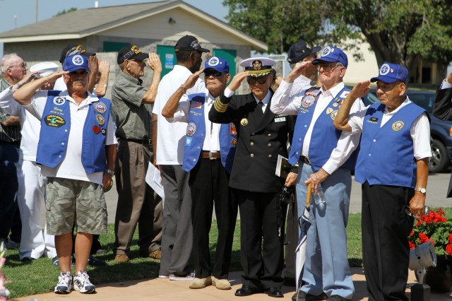 Veterans salute during the playing of the taps at the Korean Veterans Memorial dedication ceremony June 25 at Elmer Thomas Park in Lawton. The memorial was dedicated on the 62nd anniversary of North Korea crossing the 38th Parallel into South Korea.