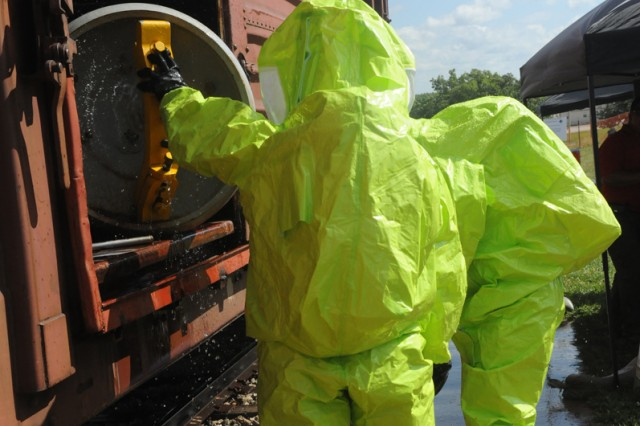 Staff Sgt. Maliek Kearney and Staff Sgt. Zachery Jones, both 22nd Chemical Battalion, seal a leaking hazardous material container at the Lt. Terry CBRN Responder Training Facility.