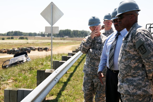 Maj. Gen. Larry D. Wyche, Combined Arms Support Command and Fort Lee commanding general, listens as Ralph Williams, Track, Metalworking and Recovery Department director, explains the training Soldiers receive while at the vehicle recovery range June 27.