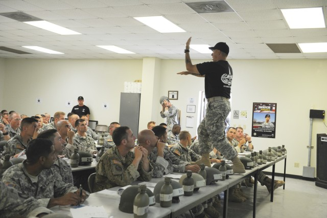 Phase One instructor Sgt. Jeremy Stillwagner demonstrates hand-arm signals Air Assault School students will have to know to successfully complete the course during study time at Fort Hood, Texas. The class, the first taught by Fort Hood-based instructors, has a capacity of 130 students.