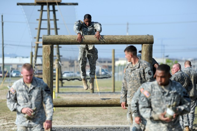 Spc. Terria Wheeler, 1st Cavalry Division, launches herself in an attempt to complete the Low Belly Over obstacle, June 23, 2012, on Zero Day of Air Assault School training at Fort Hood, Texas.