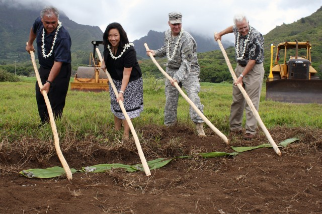 The Department of Land and Natural Resources and the U.S. Army Corps of Engineers broke ground today on the Kawainui Marsh Environmental Restoration Project in Kailua, O'ahu. The project will increase populations of endangered waterfowl, create scenic open space, reduce upland runoff to coastal reefs and remove invasive weeds from the marsh. Pictured from left to right breaking ground are William J. Aila, Jr., DLNR chairperson, Staff Member Jennifer Wooten representing Sen. Daniel K. Inouye, Honolulu District Commnder Lt. Col. Douglas B. Guttormsen and Paul Conry, Division of Forestry and Wildlife administrator.