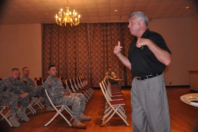 Bob Delaney, a former NBA referee and former undercover state trooper, speaks to Soldiers about post traumatic stress at the Joe E. Mann Center, June 21.