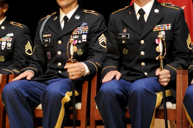 (From left) Staff Sgt. Jeffrey Heilman, representing Fort Jackson, S.C., and Staff. Sgt. Jarod Moss, assigned to the 95th Reserve Division at Fort Sill, Okla., sit with their noncommissioned officer swords after being named Active Duty and Army Reserve Drill Sergeants of the Year respectively, at the closing ceremony for the U.S. Army's 2012 Drill Sergeant of the Year competition at Fort Eustis, Va., June 29, 2012. The drill sergeants earned top honors from battalion level up through installation level, and represent the best drill sergeants in the Army.