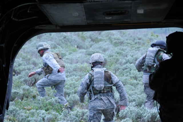 Training for the mountains of Afghanistan, the Army Reserve and Idaho Air National Guard take to the mountains near Boise, Idaho on June 21. Soldiers of Company B, 1/214th General Support Aviation Battalion practice inserting and extracting airmen of the 24th Aviation Support Operations Squadron, Joint Tactical Aircraft Controllers whose job it is to direct air assests in support of various joint and special operations. Here, JTACs exit the CH-47 helicopter as they are delivered to their insertion point.