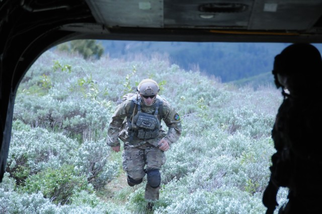 Training for the mountains of Afghanistan, the Army Reserve and Idaho Air National Guard take to the mountains near Boise, Idaho on June 21. Soldiers of Company B, 1/214th General Support Aviation Battalion practice inserting and extracting airmen of the 24th Aviation Support Operations Squadron, Joint Tactical Aircraft Controllers whose job it is to direct air assests in support of various joint and special operations. Here, a JTAC runs to the CH-47 helicopter where he will count the rest of his team as they enter to be delivered to another insertion point.
